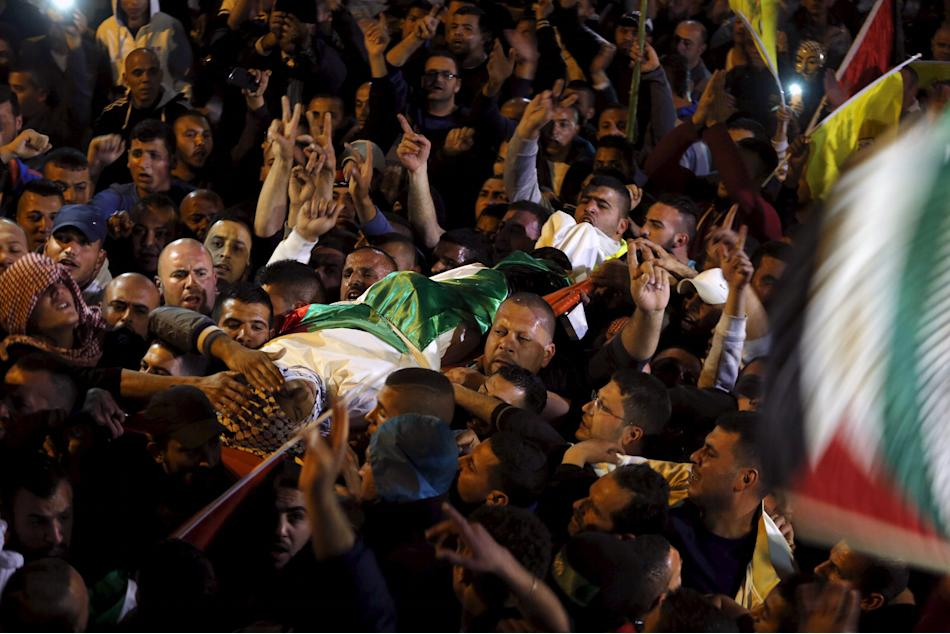 Palestinians carry the body of Ali Abu Ghannam during his funeral in the East Jerusalem neighbourhood of A-tur