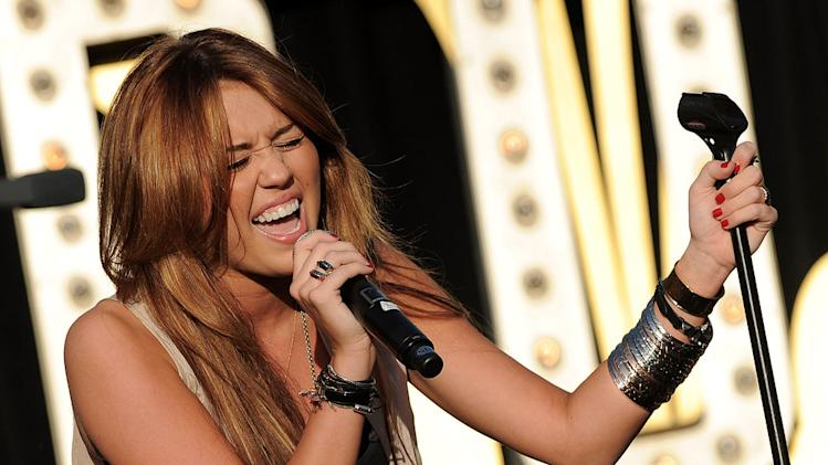 Miley Cyrus performs at the World Wish Day Celebration With Miley Cyrus at The Grove on April 28, 2010 in Los Angeles, California.