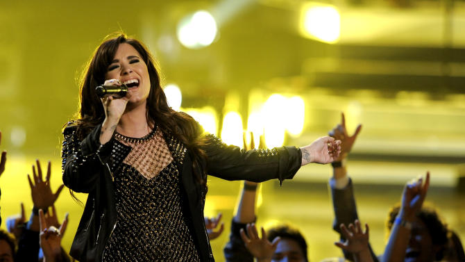 "FILE - This dec. 16, 2012 file photo shows actress-singer Demi Lovato performing at VH1 Divas at the Shrine Auditorium in Los Angeles. Lovato's  ""Heart Attack,"" was the most viral tracks on Spotify, based on the number of people who shared it divided by the number who listened to it, from Monday, Feb. 25, to Sunday, March 3.  (Photo by Chris Pizzello/Invision/AP, file)"