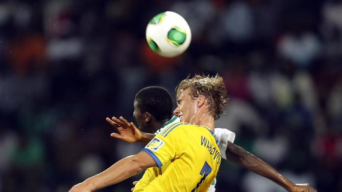Taiwo Awoniyi of Nigeria jumps for a header with Linus Wahlqvist of Sweden during their U-17 UAE World Cup semi-final soccer match in Dubai