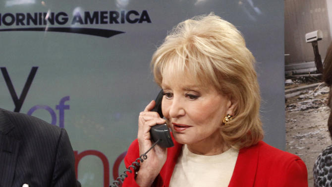 """This image released by American Broadcasting Companies shows Barbara Walters answering a phone to take donations for victims of Superstorm Sandy during """"Good Morning America,"""" Monday, Nov. 5, 2012 in New York.  Walters made a contribution of $250,000 to the American Red Cross and GMA co-host George Stephanopoulos followed suit with a donation for $50,000.  (AP Photo/American Broadcasting Companies, Lou Rocco)"""