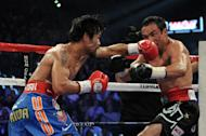 LAS VEGAS, NV - NOVEMBER 12: (R-L) Manny Pacquiao connects with a left to the head of Juan Manuel Marquez during the WBO world welterweight title fight at the MGM Grand Garden Arena on November 12, 2011 in Las Vegas, Nevada. (Photo by Harry How/Getty Images)