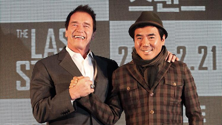 "Actor Arnold Schwarzenegger, left, poses with South Korean director Kim Jee-woon before a press conference to promote their latest film ""The Last Stand"" in Seoul, South Korea, Wednesday, Feb. 20, 2013. The movie will open on Thursday, Feb. 21, in South Korea.  (AP Photo Ahn Young-joon)"