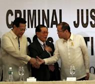 In this Monday, Dec. 5, 2011 photo provided by Malacanang Palace in Manila, Philippine President Benigno Aquino III, right, greets Supreme Court Chief Justice Renato Corona during the 1st National Criminal Justice Summit in Manila, Philippines. The Philippine House of Representatives has impeached the Supreme Court chief justice over alleged corruption and favoritism toward arrested ex-President Gloria Macapagal Arroyo. A majority of the 284 members of the powerful House signed a resolution to impeach Chief Justice, officials said Monday, Dec. 12. (AP Photo/Malacanang Photo Bureau, Gil Nartea) EDITORIAL USE ONLY, NO SALES