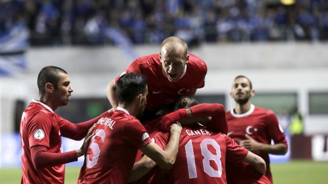Turkey team players celebrate scoring a goal during their 2014 World Cup qualifying soccer match against Estonia in Tallinn