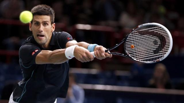 Paris Masters - Djokovic overcomes Isner to set up Wawrinka clash