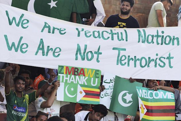 Pakistani cricket fans cheer during the 1st one-day international match between Pakistan and Zimbabwe at Gaddafi Stadium in Lahore, Pakistan, Tuesday, May 26, 2015. (AP Photo/K.M. Chaudary)