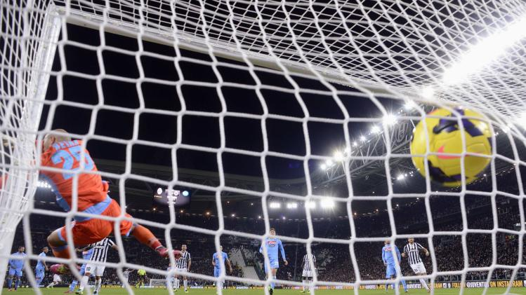 Juventus' Pirlo shoots to score past Napoli's goalkeeper Reina during Italian Serie A match in Turin