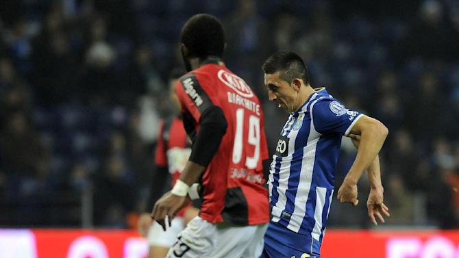FC Porto's Hector Herrera, right, from Mexico controls the ball past Olhanense's Oumar Diakhite, from Senegal, in a Portuguese League soccer match at the Dragao Stadium in Porto, Portugal, Friday, Dec. 20, 2013. Herrera scored once in Porto's 4-0 victory