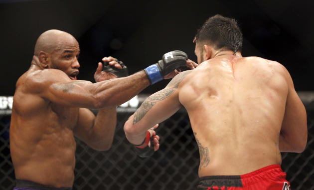 Brad Tavares, right, and Yoel Romero fight in a UFC mixed martial arts bout Saturday, April 19, 2014, in Orlando Fla. (AP Photo/Reinhold Matay)