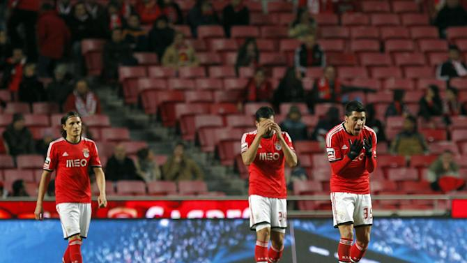 Benfica's Enzo Perez, from Argentina, Ezequiel Garay, also from Argentina, and Fejsa, from Serbia, from right to left, react after Arouca scored their second goal during a Portuguese league soccer match between Benfica and Arouca at Benfica's Luz stadium in Lisbon, Friday, Dec. 6, 2013. The match ended in a 2-2 draw