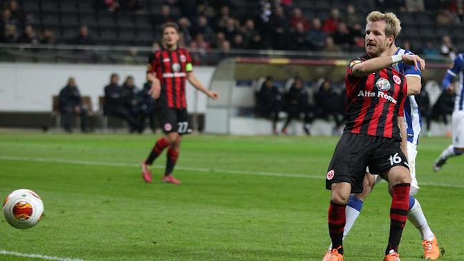 Frankfurt's Stefan Aigner scores his side's opening goal during a Europa League round of 32 second leg soccer match between Eintracht Frankfurt and FC Porto in Frankfurt, Germany, Thursday, Feb. 27, 2014