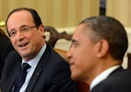 "US President Barack Obama (R) listens as French President Francois Hollande speaks following their bilateral meeting in the Oval Office. Obama told Hollande that their countries' bilateral relationship is ""deeply valued"" by Americans"