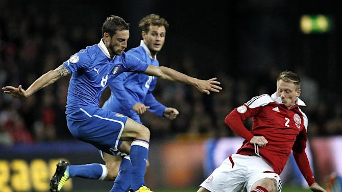 Italy's Claudio Marchisio, left, and Alessandro Diamanti and Denmark's Niki Zimling during the 2014 World Cup Group B qualifying soccer match between Denmark and Italy at Parken Stadium in Copenhagen, Denmark, Friday Oct. 11, 2013