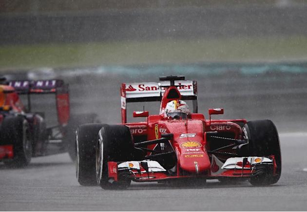 Vettel wins Malaysian GP to end Mercedes streak