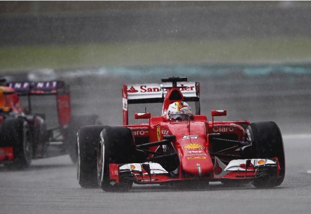 Vettel wins Malaysian GP to end Mercedes streak