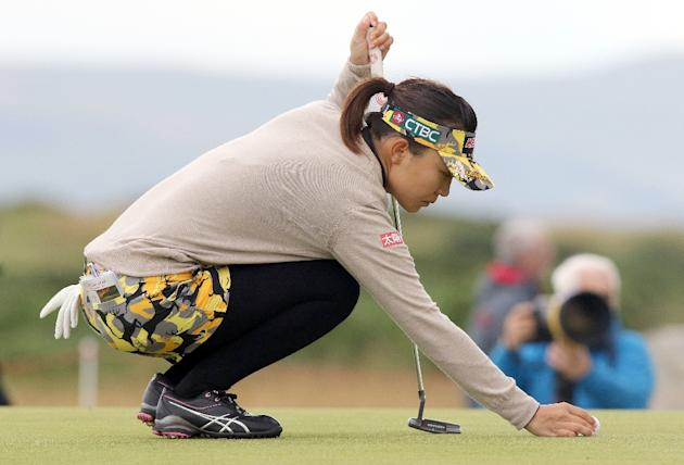 Taiwan's Teresa Lu places her ball on the 13th green, during her third round, on day three of the Women's British Open Golf Championships in Turnberry, Scotland, on August 1, 2015