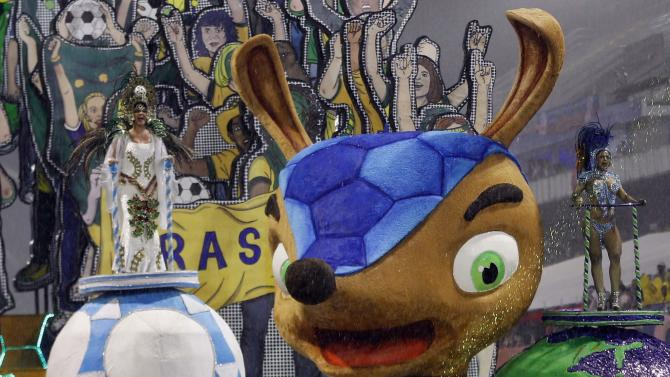 The official mascot of the FIFA 2014 World Cup, Fuleco the Armadillo, is seen on a float of Leandro de Itaquera samba school during the first night of the Special Group of the annual Carnival parade in Sao Paulo's Sambadrome