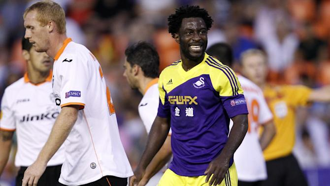 Swansea City's Wilfried Bony from the Ivory Coast  reacts after failing to score against Valencia, during their Europa  League Group A soccer match at the Mestalla stadium in Valencia, Spain, Thursday , Sept. 19, 2013