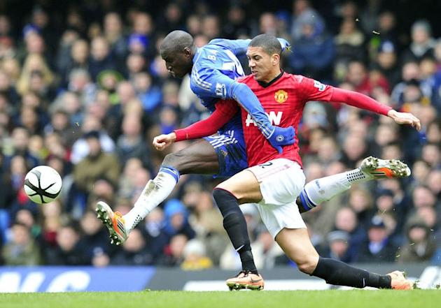 Manchester United's English defender Chris Smalling (R) vies with Chelsea's Senegalese striker Demba Ba (L) during their English FA Cup quarter final replay football match at Stamford Bridge in London, England on April 1, 2013. Chelsea won 1-0