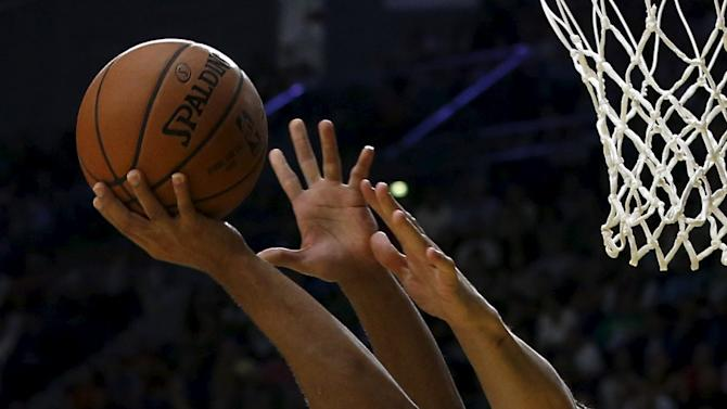 Boston Celtics' Bradley goes up for a basket Real Madrid's Maciulis during their NBA Global Games friendly basketball game in Madrid