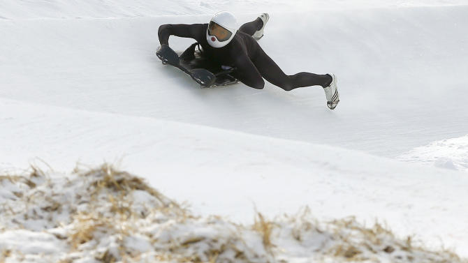 A rider speeds down on the natural ice run of the Cresta Run at the private St. Moritz Tobogganing Club