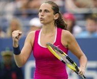 Roberta Vinci of Italy reacts to a point against Agnieszka Radwanska of Poland during their women's singles match at the 2012 US Open tennis tournament in New York. Vinci won 6-1, 6-4