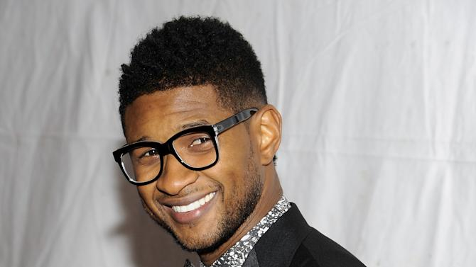 "FILE - This Nov. 17, 2011 file photo shows singer Usher Raymond at the ""Pencils Of Promise"" inaugural gala in New York. The Grammy-winning singer is collaborating with Macy's to curate the concept, music and design behind the company's annual July 4 fireworks extravaganza. Macy's said Thursday, May 9, 2013, it's the first time the company has worked with an artist on the concept.  (AP Photo/Evan Agostini, file)"