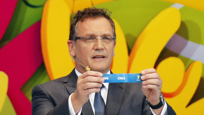 "FIFA Secretary General Jerome Valcke holds the slip showing ""Chile"" during the draw for the 2014 World Cup at the Costa do Sauipe resort in Sao Joao da Mata"