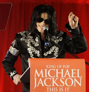 "FILE - In this March 5, 2009 file photo, Michael Jackson announces several concerts at the London O2 Arena in July, at a press conference at the London O2 Arena. AEG Live LLC CEO Randy Phillips told a jury on Wednesday June 12, 2013, that he saw Jackson as a forceful businessman who knew what he wanted and who he wanted to work with during preparations for his ill-fated ""This Is It"" shows. Phillips concluded his testimony after eight days in a case filed by the singer's mother, Katherine Jackson, over her son's death, claiming AEG Live should be held responsible for hiring the doctor convicted of giving the superstar a lethal dose of an anesthetic. (AP Photo/Joel Ryan, file)"