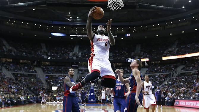 Miami Heat small forward LeBron James (6) drives against the Detroit Pistons in the second half of an NBA basketball game in Auburn Hills, Mich., Sunday, Dec. 8, 2013