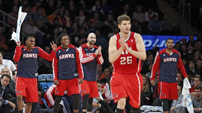 Atlanta Hawks' Kyle Korver (26) and the Hawks' bench react after scoring against the New York Knicks during the second half of an NBA basketball game Saturday, Nov. 16, 2013, in New York.  Atlanta defeated New York 110-90