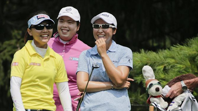 Teresa Lu, of Taiwan, left, Shanshan Feng, of China, center, and Candie Kung, of Taiwan, right, smile after hitting a tee shot on the 17th green during a practice round for the U.S. Women's Open golf tournament at Lancaster Country Club, Tuesday, July 7, 2015, in Lancaster, Pa. (AP Photo/Frank Franklin II)