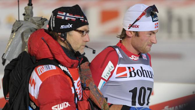 Norway's Petter Northug (R) is helped after he crosses the finish line to win the men's individual 10 km free style cross country skiing event during the FIS World Cup Ruka Nordic Opening in Kuusamo, on November 26, 2011.     AFP PHOTO/ LEHTIKUVA/ HEIKKI SAUKKOMAA      *** FINLAND OUT *** (Photo credit should read HEIKKI SAUKKOMAA/AFP/Getty Images)