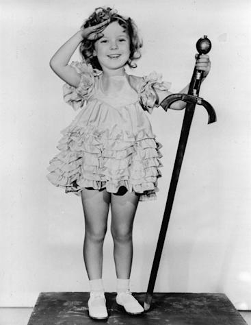 "FILE - In this 1933 file photo, child actress Shirley Temple is seen in her role as ""Little Miss Marker"". Shirley Temple, the curly-haired child star who put smiles on the faces of Depression-era moviegoers, has died. She was 85. (AP Photo/File)"