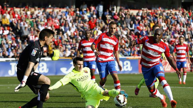Barcelona's Messi kicks the ball the ball next to Granada's goalkeeper Olazabal during their Spanish first division soccer match in Granada