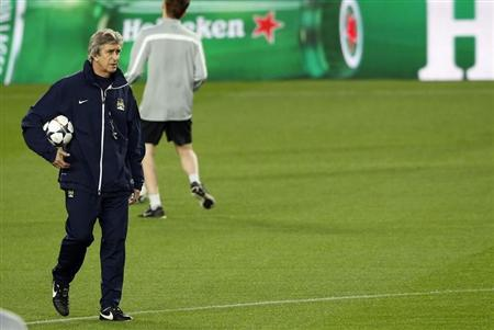 Manchester City's coach Luis Pellegrini attends a training session at Camp Nou stadium in Barcelona