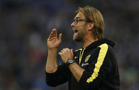 Borussia Dortmund's coach Klopp reacts during the German first division Bundesliga soccer match against Schalke 04 in Gelsenkirchen