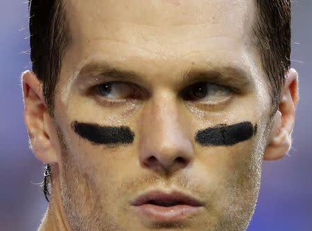 File of New England Patriots quarterback Tom Brady taking his helmet off during warm-ups ahead of the start of the NFL Super Bowl XLIX in Glendale