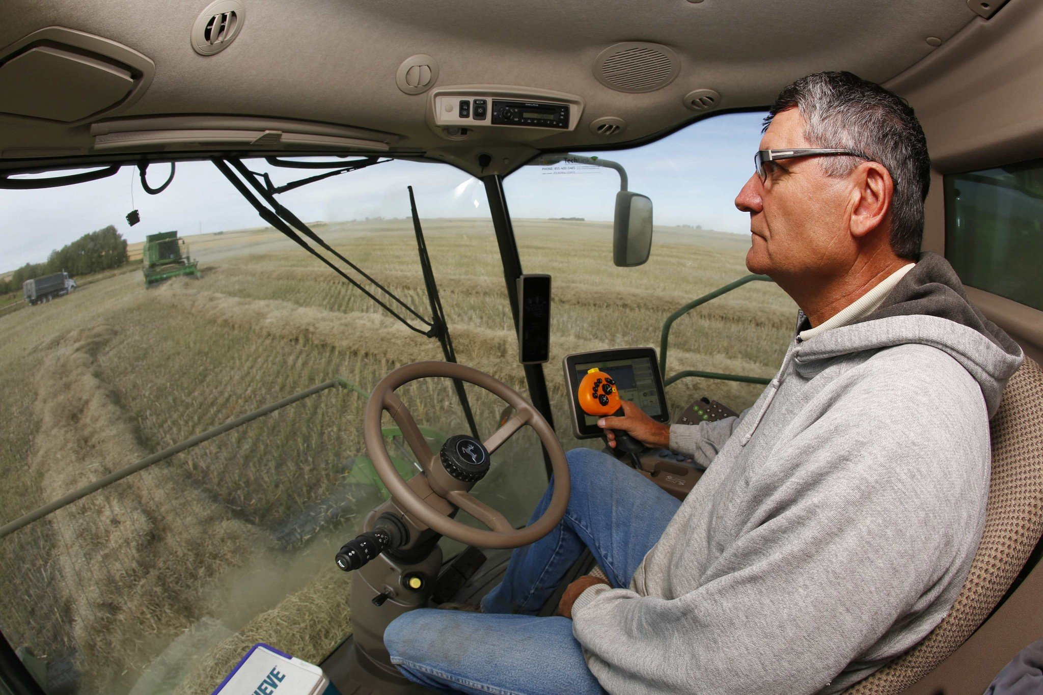 Farmer Barry Lang harvests canola with his crew on his farm near Beiseker, Alberta, in this file photo taken September 27, 2013. Working for yourself has plenty of benefits, but requires some extra work come tax time. (Reuters)