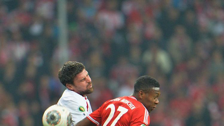 Bayern's David Alaba of Austria , right, and Kaiserslautern's Florian Dick challenge for the ball during the German soccer cup, DFB Pokal, semifinal match between FC Bayern Munich and FC Kaiserslautern in the Allianz Arena in Munich, Germany, on Wednesday, April 16. 2014
