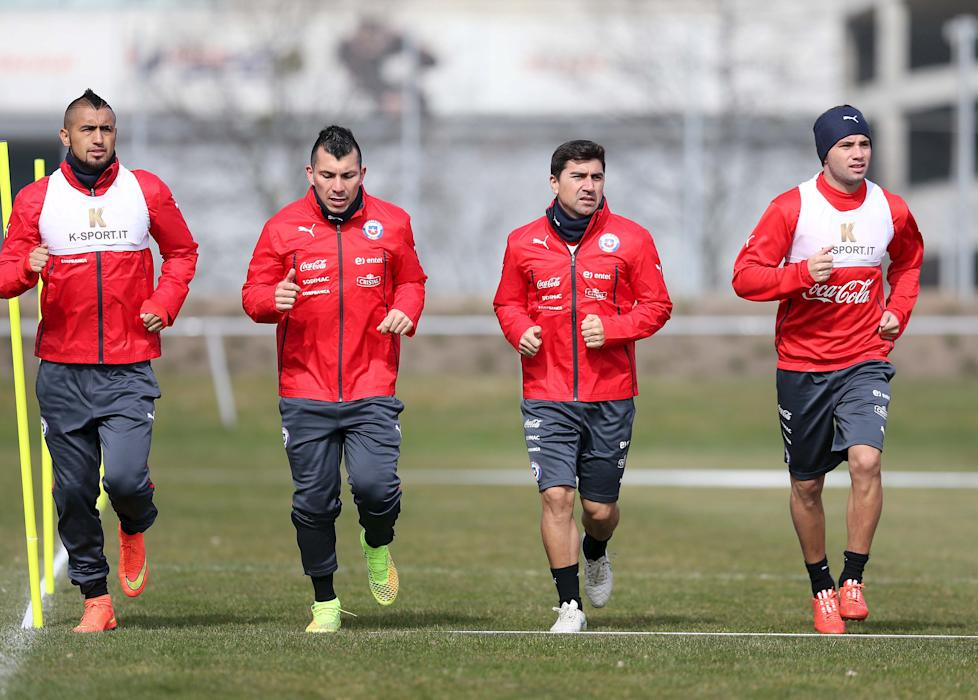Chile's national soccer player Arturo Vidal, Gary Medel, David Pizarro and Eugenio Mena attend a training session at St. Polten