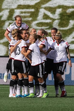 OTTAWA, ON - JUNE 7: Melanie Behringer #7 of Germany jumps to celebrate a goal with her teammates including Sara Dabritz #23 and Anja Mittag #11 during the FIFA Women's World Cup Canada 2015 Group B match between Germany and Cote d'Ivoire at Lansdowne Stadium on June 7, 2015 in Ottawa, Canada. (Photo by Andre Ringuette/Getty Images)
