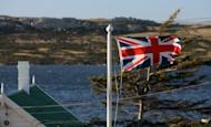 The Union Jack waves over Stanley in the Falkland Islands. The Falkland Islands will hold a referendum on its political status in 2013 in a bid to end the bitter territorial dispute between Britain and Argentina, the archipelago's government said