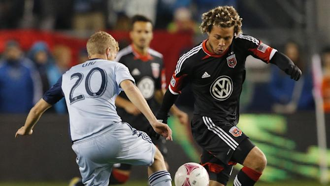 D.C. United midfielder Nick DeLeon, right, carries the ball past Sporting KC midfielder Oriol Rosell (20) during the first half of an MLS soccer match in Kansas City, Kan., Friday, Oct. 18, 2013