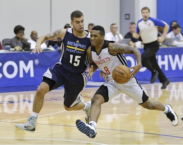 Houston Rockets' Jahii Carson drives past Memphis Grizzlies' Scottie Wilbekin (15) during an NBA summer league basketball game in Orlando, Fla., Thursday, July 10, 2014