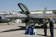 US Air Force Pilot gives explanations next to a F-16 C/D jet in 2005. The House of Representatives has voted to require the United States to sell 66 new fighter-jets to Taiwan, with lawmakers saying the deal would close a growing military gap with China