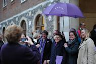 """Female members of the clergy and visitors pose outside the venue of the Church of England General Synod in central London on November 20. The Church of England has """"undoubtedly"""" lost credibility after voting to reject the appointment of women bishops, its leader the Archbishop of Canterbury said Wednesday."""
