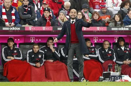 Bayern Munich's head coach Guardiola gestures during their German Bundesliga first division soccer match against Schalke 04 in Munich
