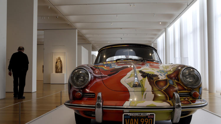 In this photo taken Wednesday, Oct. 9, 2013 a 1965 Porsche Type 356 C Cabriolet that once belonged to Janis Joplin is on display in the Porsche By Design exhibit at the North Carolina Museum of Art in Raleigh, N.C. (AP Photo/Gerry Broome)